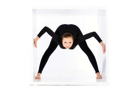 tight body: Modern bellet dancer posing with a cube at studio. Plastic body concept. Isolated over white.