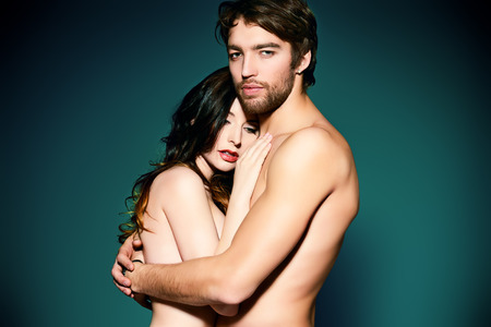 Beautiful naked couple in love in a tender embrace. photo