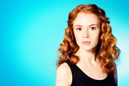 redhaired: Portrait of a pretty red-haired girl. Copy space. Stock Photo