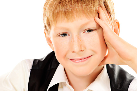 hairdo: Portrait of a smiling ten years boy. Education. Isolated over white.