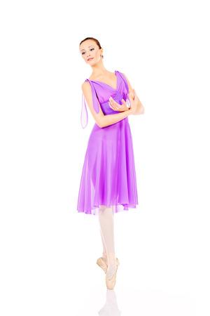 Beautiful elegant bellet dancer dancing at studio. Isolated over white. Stock Photo