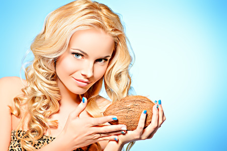 Portrait of a beautiful young woman holding coconut. Healthy nutrition, diet. photo