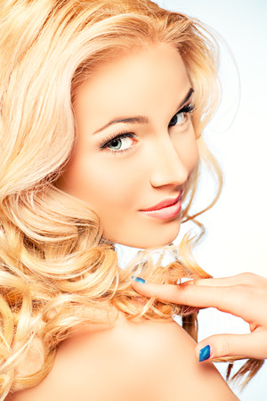bodycare: Portrait of a smiling woman with beautiful blonde hair. Hair care. Beauty, fashion.