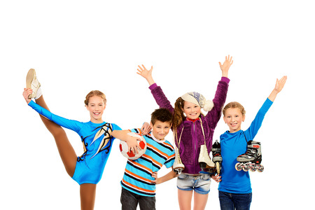 Group of children, fond of different sports, standing together and smiling. Isolated over white. photo