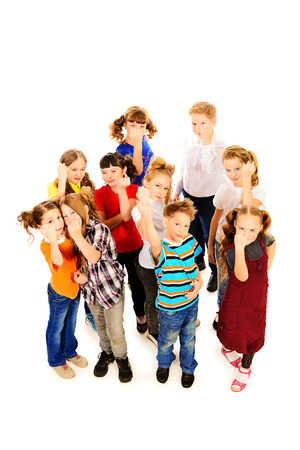 threatens: Group of angry children threatens fists into camera. Isolated over white. Full length portrait.