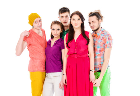 Group of bright young people standing together. Isolated over white. photo