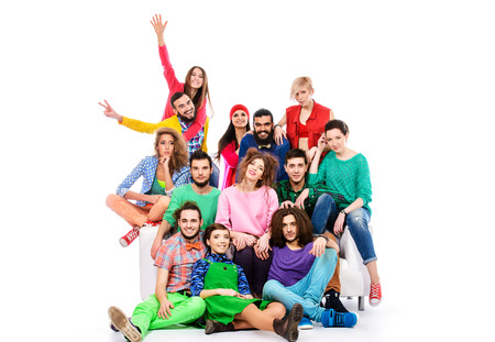 Large group of cheerful young people. Isolated over white. photo