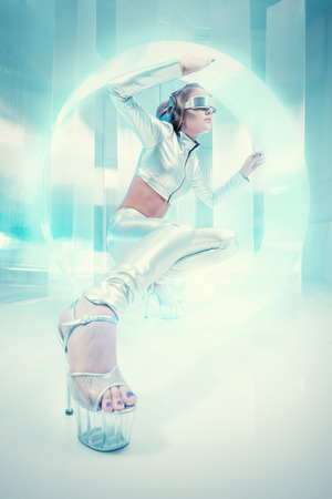 cyber woman: Beautiful young woman in silver latex costume with futuristic hairstyle and make-up. Sci-fi style.