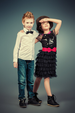 Full length portrait of two modern kids posing together. Fashion shot.   photo