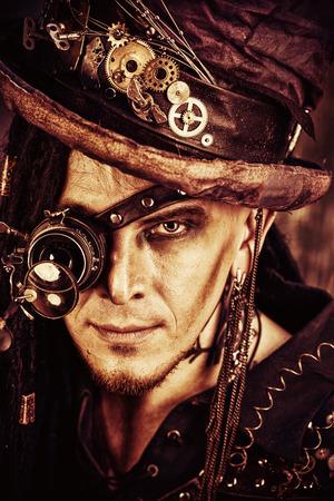 Portrait of a steampunk man over grunge background. photo