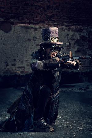 Portrait of a steampunk man in the ruins. photo