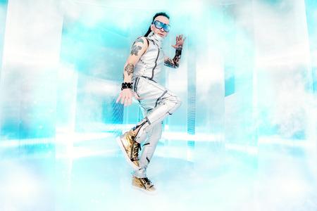 futuristic man: Portrait of the eccentric futuristic man in silver costume. Innovations and high technology. Rock artist.
