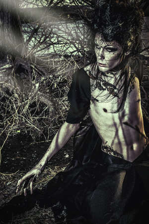 scary man: Man-tree in a wild wood. Art project. Fantasy. Halloween. Stock Photo