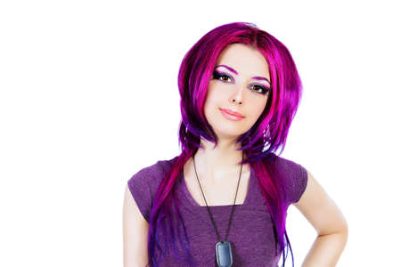 hair coloring: Beautiful young woman with bright crimson hair. Skin care. Hair coloring. Isolated over white.