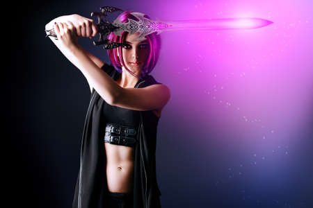Beautiful girl warrior with a sword standing in fighting stance. Anime. Fantasy. Stock Photo