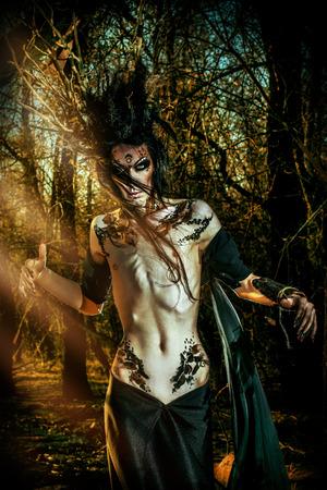 Man-tree in a wild wood. Art project. Fantasy. Halloween. photo