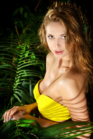 Beautiful sexual young woman in bikini in the rainforest. Vacation. Tropics. photo