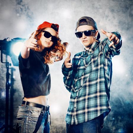 hip hop style: Two modern dancers over grunge