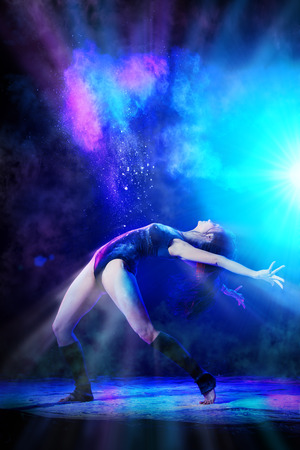 Beautiful expressive ballet dancer dancing at studio.