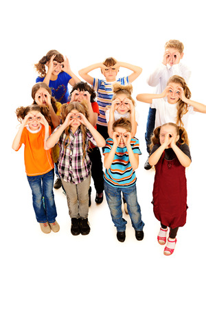 classmates: Group of cheerful schoolchildren standing together and facing the same direction. Isolated over white.