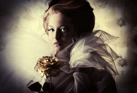 aristocracy: Beautiful fashion model in the refined white dress and elegant hat. Vintage style. Art project. Stock Photo