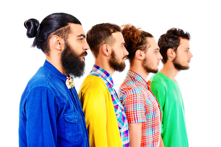 Portrait in profile of group of modern bearded men standing in a row. Isolated over white. Stock Photo