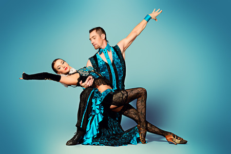 Beautiful professional dancers perform tango dance with passion and expression.  Stock Photo