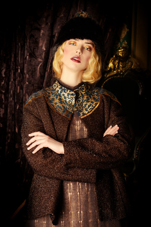 russian woman: Portrait of a beautiful fashion model in a rich historical costume. Fur clothing. Vintage. Luxury style.