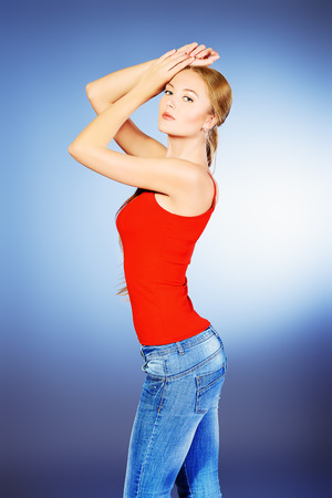 slender woman: Portrait of a young slender woman wearing jeans.