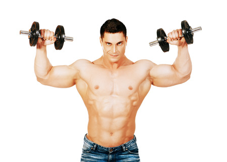 Portrait of a handsome muscular bodybuilder posing with dumbbell. Isolated over white background. photo