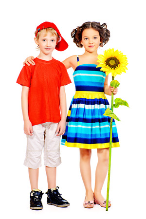 Happy summer children in bright clothes standing together. Isolated over white. photo