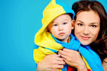 after bath: Happy young mother and her adorable son after bath. Healthcare. Stock Photo