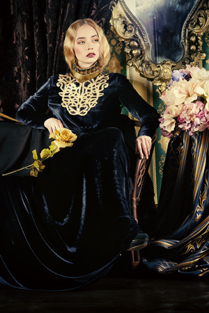 velvet dress: Beautiful fashion model in a rich historical dress. Vintage. Luxury style.