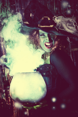 sexy witches: Fairy wicked witch in the wizarding lair. Magic. Halloween.