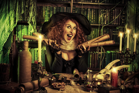 witchery: Attractive witch in the wizarding lair. Fairytales. Halloween.
