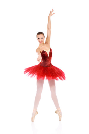 Professional bellet dancer posing at studio. Isolated over white background.  photo