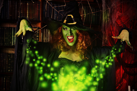 wicked woman: Fairy wicked witch in the wizarding lair. Magic. Halloween.