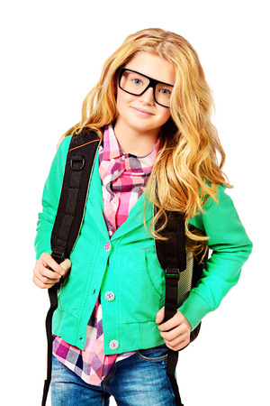 Portrait of a smart ten years girl in big glasses. Education. Isolated over white. photo