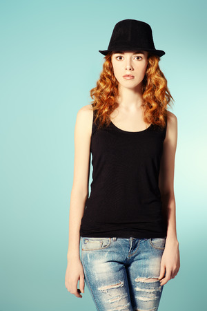 Portrait of a pretty red-haired girl. Copy space. photo
