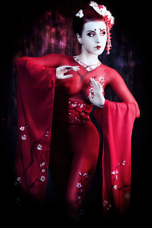 body painting: Art portrait of a stylized Japanese geisha. Body painting project.