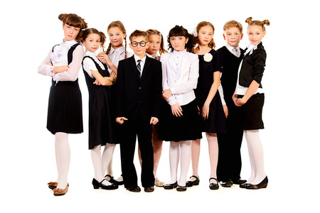 Group of cheerful schoolchildren standing together. Full length portrait. Isolated over white. photo