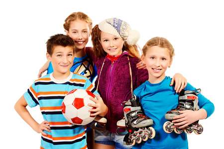 fond of children: Group of children, fond of different sports, standing together and smiling. Isolated over white.