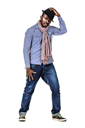 cool guy: Full length portrait of a modern african american young man dancing at studio. Isolated over white. Stock Photo