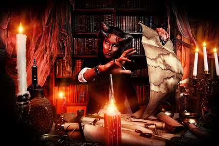 Horned Devil in his home. Fantasy. Ancient style. Halloween. photo