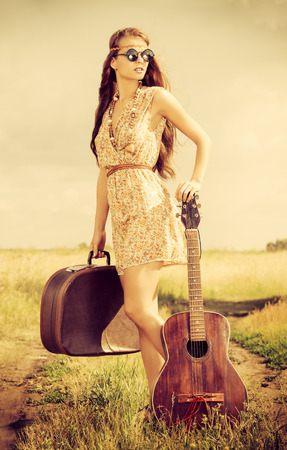 Romantic girl travelling with her guitar. Summer. Hippie style.  photo