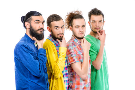 men standing: Group of modern bearded young men standing in a row. Isolated over white.