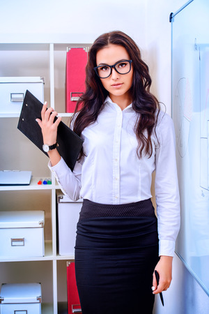 Business woman making a presentation at the office.  photo