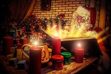 Santa Claus reading fairytales at home. Christmas.