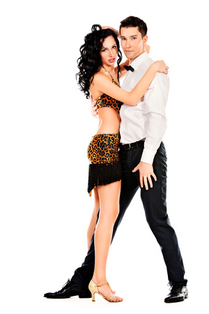 latin dance: Beautiful professional artists dancing passionate dance. Isolated over white. Stock Photo