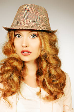 natural wonders: Close-up portrait of a beautiful young woman with surprised look. Make-up, fashion.